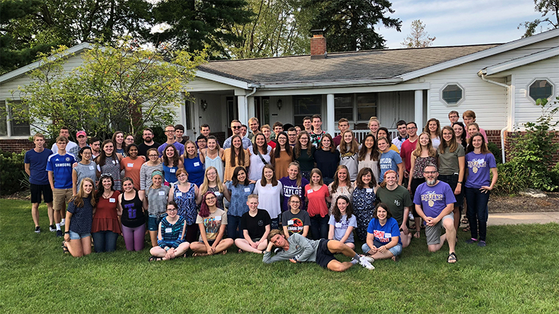 Group of Honors Guild students in front of a house for a cookout.