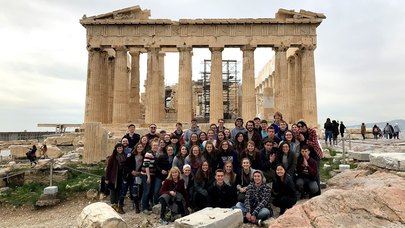 Group of Honors Guild students and professors in front of the Parthenon in Greece.