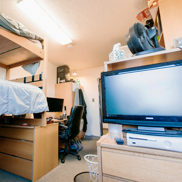 Each room is furnished with beds, shelves, chairs, desks, and drawer units.