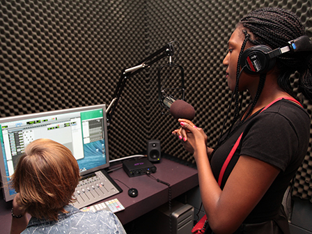 Students record voice-overs in a private audio editing suite.